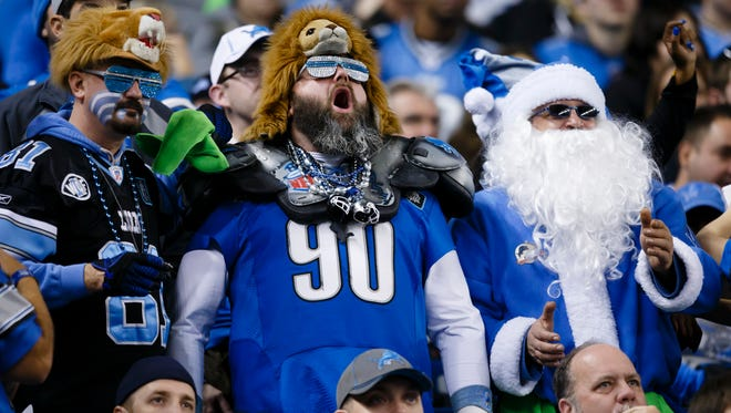Detroit Lions fans cheer against the Tampa Bay Buccaneers at Ford Field in Detroit on Dec. 7, 2014.