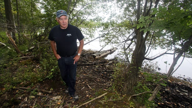 Retired New York State Police investigator George Johansen walks along the bank of the Croton Reservoir in Yorktown, near the  area where the body of Sherri Orofino was found on Aug. 9, 1987. Johansen investigated the murder when it happened. Orofino, a resident of Millbrook, N.Y. was reported missing on March 1, 1987. Her car was found off the Taconic State Parkway at route 134. The crime has gone unsolved.