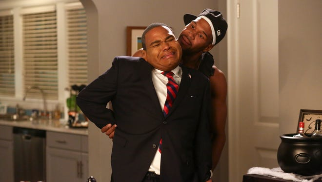 Dre (Anthony Anderson), front, gets a surprise visit from his cousin, June Bug (Michael Strahan), who used to torment Dre as a kid, on 'Black-ish.'