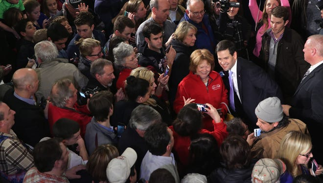 Marco Rubio poses for a photograph at a town hall in Exeter, N.H., on Feb. 2, 2016.