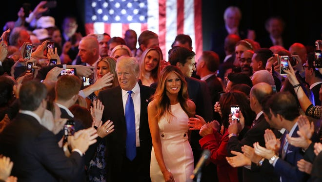Republican presidential candidate Donald Trump and his wife Melania Trump greet supporters, following his victory Tuesday in the Indiana primary.