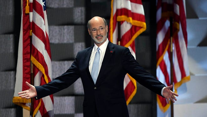 Pennsylvania Gov. Tom Wolf walks on stage before speaking during the 2016 Democratic National Convention at Wells Fargo Center.