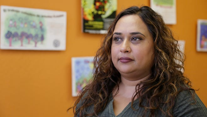 In this photo taken Friday, Sept. 2, 2016, Rajasvini Bhansali, executive director of the International Development Exchange, also known as IDEX, poses at her office in San Francisco. Black Lives Matter has quietly established a legal partnership with the California charity in a sign of the movement's growth and expanding ambition.