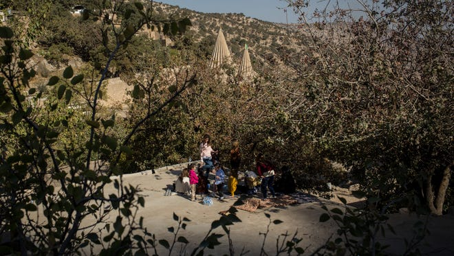 Yazidi women and children picnic on the rooftop overlooking the holiest temple of the Yazidi faith while attending Friday rituals on November 11, 2016 in Lalish, Iraq. Lalish is the site of the tomb of Sheikh Adi ibn Musafir, the central figure of the Yazidi faith.  In 2014 thousands of Yazidis fled to the villages of Lalish and Shekhan after ISIS took control of Sinjar and other Yazidi populated towns. Many Yazidi resettled in Mosul and Bashiqah but were forced to flee again when ISIS took control of the cities. The liberation of Bashiqah four days ago by the Iraqi army and the continuing Mosul offensive has given many  Yazidi 's hope they will soon be able to return home.