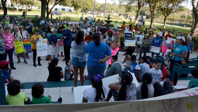 Annisa Karim, of the American Muslim Democratic Caucus of Florida, speaks to a group of about 250 people gathered at the Collier County Government Complex on Saturday afternoon to protest President Trump's immigration orders, and speak out for tolerance and openness.