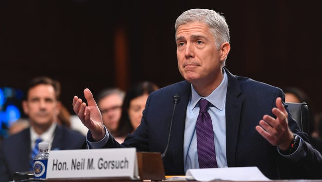 Supreme Court nominee Neil Gorsuch answers questions on day two of his confirmation hearing on March 21.