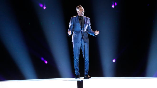 "Knoxville's Chris Blue sings ""Take Me to the King"" in ""The Voice"" semifinals."