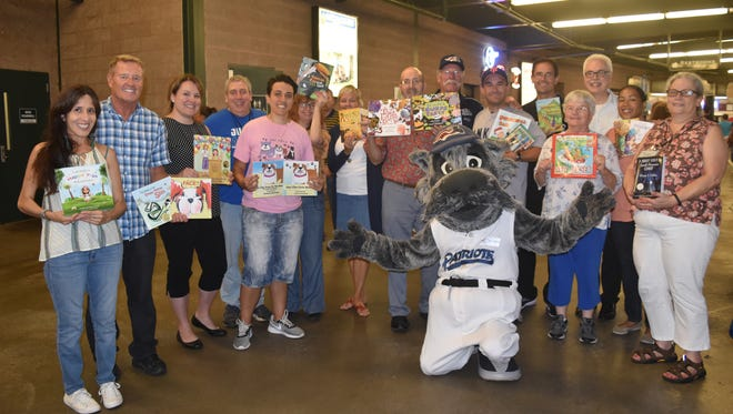 Participants in the 2017 Super Summer Reader Author Celebration show off their works during the Aug. 15 event conducted at the Somerset Patriots' TD Bank Ballpark in Bridgewater.