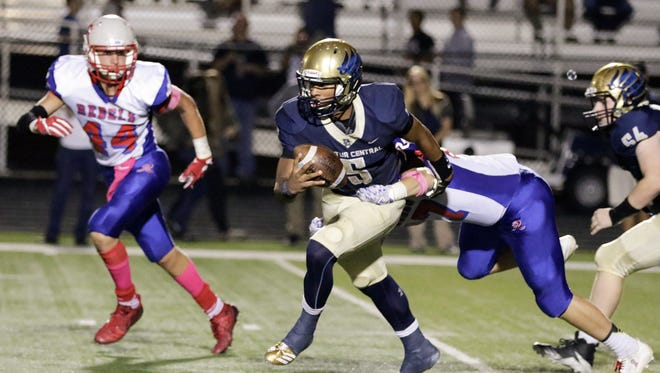 Decatur Central QB Bryce Jefferson (5) helped lead the Hawks past top-ranked Roncalli.
