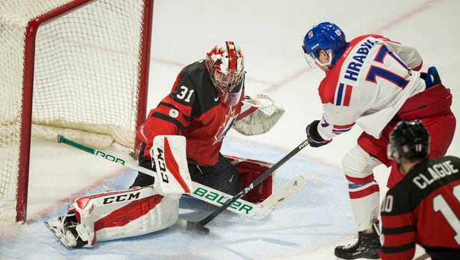 Czech Republic's Krystof Hrabik tries to put the puck past Canada goalie Carter Hart during the third period of a World Junior Championship exhibition game.