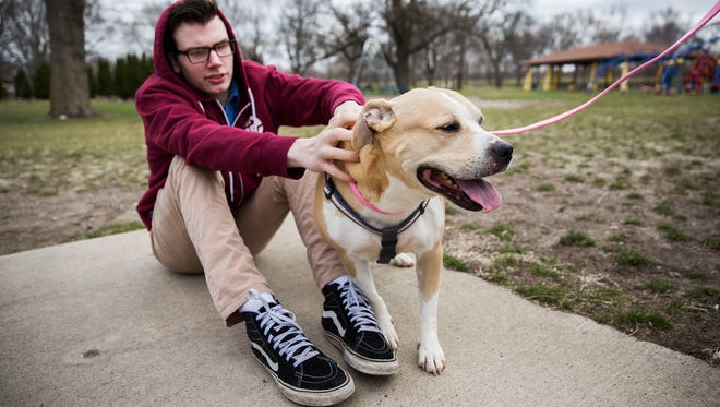 Pinky, a 9-year-old dog, is reunited with her former owner Quinten Bickel, of Des Moines, on Monday, April 16, 2018, in Des Moines. The Iowa Court of Appeals ruled that Pinky be released after two years in confinement by the city for being accused of attacking a cat.