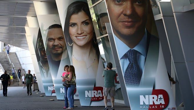 Attendees enter  the NRA Annual Meeting & Exhibits at the Kay Bailey Hutchison Convention Center on May 5, 2018 in Dallas, Texas.  The National Rifle Association's annual meeting and exhibit runs through Sunday.