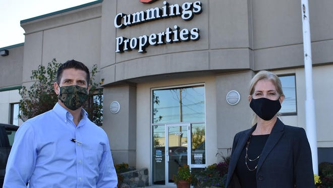 Cummings Properties President Eric Anderson, left, with new Director of Sales Susan White.