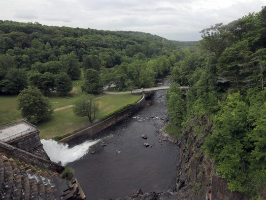 Water flows out of a spillway in the Croton Dam into