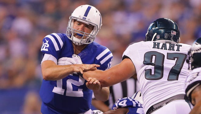 Indianapolis Colts quarterback Andrew Luck (12) is hit in the backfield on a fourth-and-one play during the first half of an NFL football game Saturday, Aug. 27, 2016, at Lucas Oil Stadium.