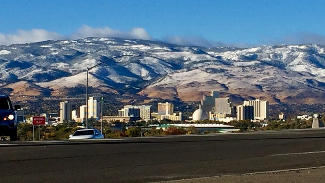 A bit of snow dusts the mountains above Reno on Friday, Oct. 20, 2017.
