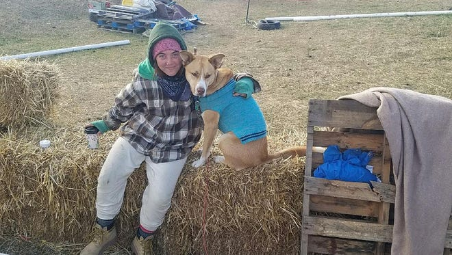 Sydney Johnson, 20, and her dog are protesting the building of the Dakota Access Pipeline in North Dakota. She was arrested Thursday and faces several charges, including felony reckless endangerment..