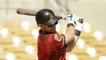 Arizona Diamondbacks' Chris Owings hits an RBI single, driving in Jake Lamb against the Chicago White Sox in the 2nd inning during spring training action on Mar. 1, 2017 at Camelback Ranch-Glendale in Phoenix, Ariz.