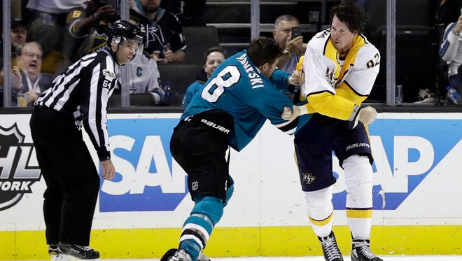 San Jose Sharks' Joe Pavelski (8) fights with Nashville Predators' Ryan Johansen during the third period of an NHL hockey game Wednesday, Nov. 1, 2017, in San Jose , Calif. (AP Photo/Marcio Jose Sanchez)