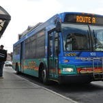 A City of Pough- keepsie bus, below, and a Dutchess County LOOP bus, above, drop off and pick up riders on Friday at the transit hub in the City of Pough- keepsie. Darryl Bautista/ Poughkeep- sie Journal