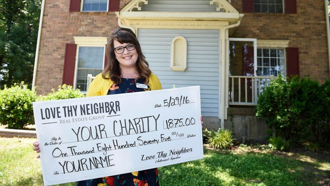 Realtor Kayla Eaton, with Love Thy Neighbor real estate group, poses at a client's house in Antioch. She will donate 25 percent of her profits to the client's chosen charity.