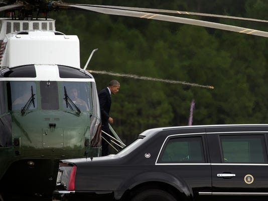 President Barack Obama arrives in Fort Lee, Va., to participate in a town hall meeting with military personnel and their families.