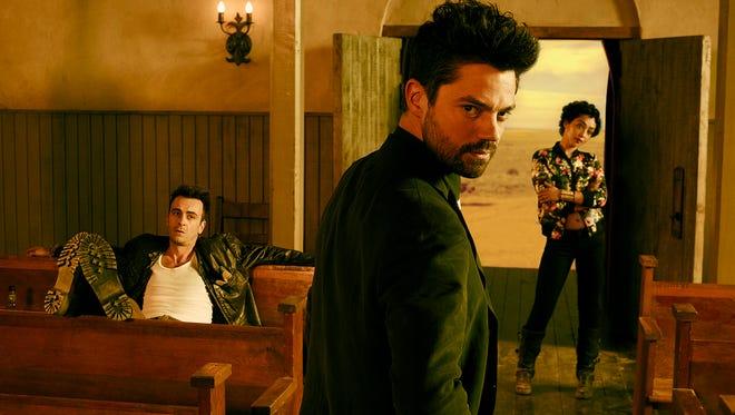 "Joseph Gilgun as Cassidy, Dominic Cooper as Jesse Custer, and Ruth Negga as Tulip O'Hare in AMC's ""Preacher."""