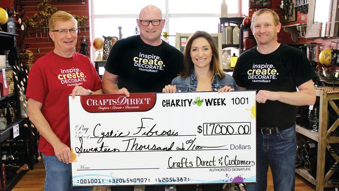 Crafts Direct owner John Schlecht and his sons Scott and Jason presented a check to Sara Shaw of the Cystic Fibrosis Foundation last April.