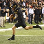 Southern Miss quarterback Nick Mullens (9) crosses the goal line against Old Dominion last week at M.M. Roberts Stadium.