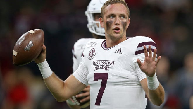 Mississippi State Bulldogs quarterback Tommy Stevens (7) warms up before their NCAA football game against the Louisiana-Lafayette Ragin Cajuns in New Orleans, Saturday, Aug. 31, 2019. (AP Photo/Chuck Cook)