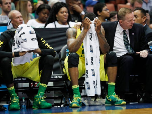 Oregon forward Dwayne Benjamin, left, and forward Elgin Cook react to their loss against Oklahoma during an NCAA college basketball game in the regional finals of the NCAA Tournament, Saturday, March 26, 2016, in Anaheim, Calif. (AP Photo/Gregory Bull)