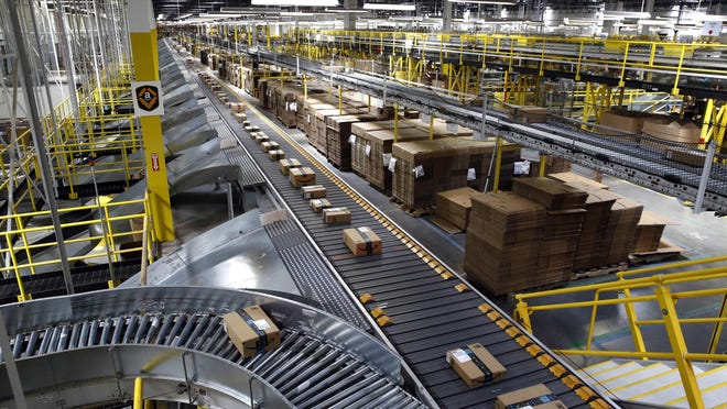 Packages ride on a conveyor system at an Amazon fulfillment center in Baltimore in this 2017 file image. Amazon is building a similar facility in the White Oak Business Park off Interstate 20 near Appling.