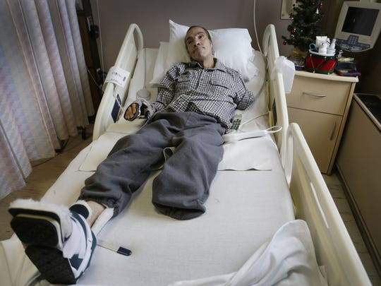 Steve Constantine is pictured in December recovering from a near fatal dog mauling in Detroit in which he lost an arm, leg and his left ear.