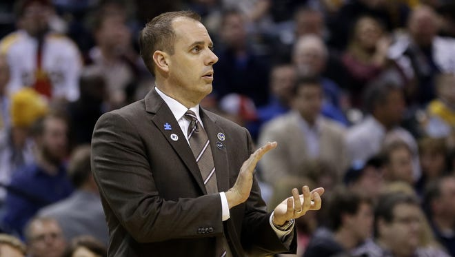 Indiana Pacers head coach Frank Vogel claps after calling a timeout against the Orlando Magic at Bankers Life Fieldhouse on March 31, 2016.