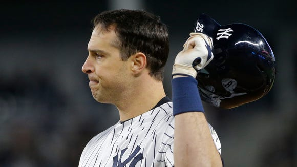 New York Yankees' Mark Teixeira reacts after being thrown out at first base during the sixth inning of a baseball game against the Seattle Mariners on Friday, April 15, 2016, in New York.