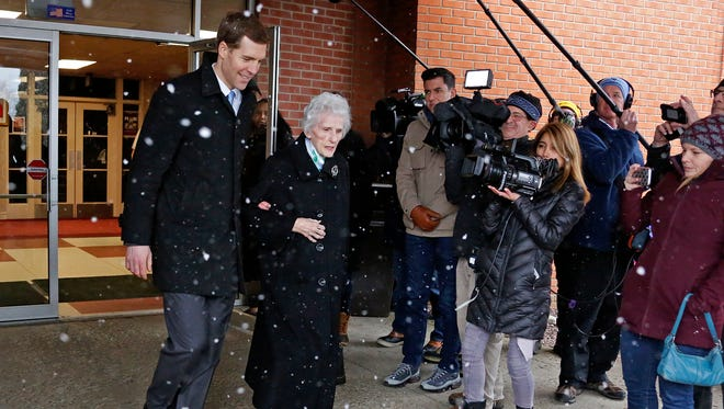 Conor Lamb, the Democratic candidate for the special election in Pennsylvania's 18th Congressional District, left, leaves a polling place after taking his grandmother Barbara Lamb to vote in Carnegie, Pa., Tuesday, March 13, 2018.