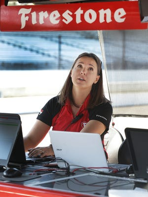 Cara Adams, chief engineer at Firestone, works from their trackside pit box near Gasoline Alley during qualifying for the IndyCar Grand Prix Friday, May 12, 2017, at the Indianapolis Motor Speedway.