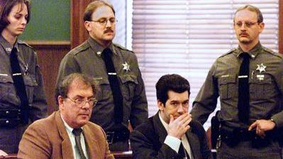 In this 2002 photo, Peter Wlasuiuk (seated right) listens to his first guilty verdict in Chenango County Court for second-degree murder in the April 2002 death of his wife, Patricia Wlasiuk.