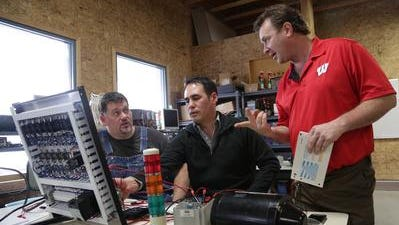 Apprentices Brian Cunningham, of Wausau, left, and Ken Liebnitz, of Rhinelander, work with industrial electrical and instrumentation apprenticeship instructor James Koskey at Northcentral Technical College in Wausau.