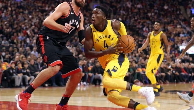 Dec 1, 2017; Toronto, Ontario, CAN; Indiana Pacers guard Victor Oladipo (4) goes to the basket against Toronto Raptors center Jonas Valanciunas (17) at Air Canada Centre. Mandatory Credit: Tom Szczerbowski-USA TODAY Sports