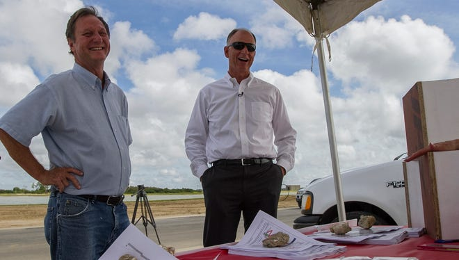 From right, Syd Kitson, Chairman and CEO of Kitson & Partners, chats with Brian Bishop, of New Panel Homes, at one of the future home sites in Babcock's first neighborhood under construction in Charlotte County. The developer filed an application last week to extend the the community into Lee.
