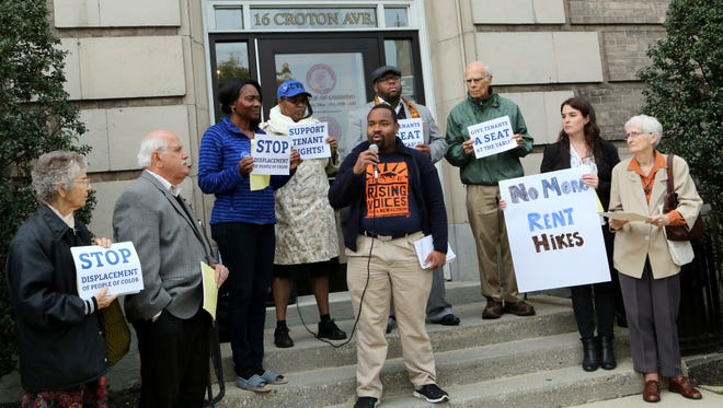 Ossining Village Trustee Quantel Bazemore speaks during a rally outside village hall.