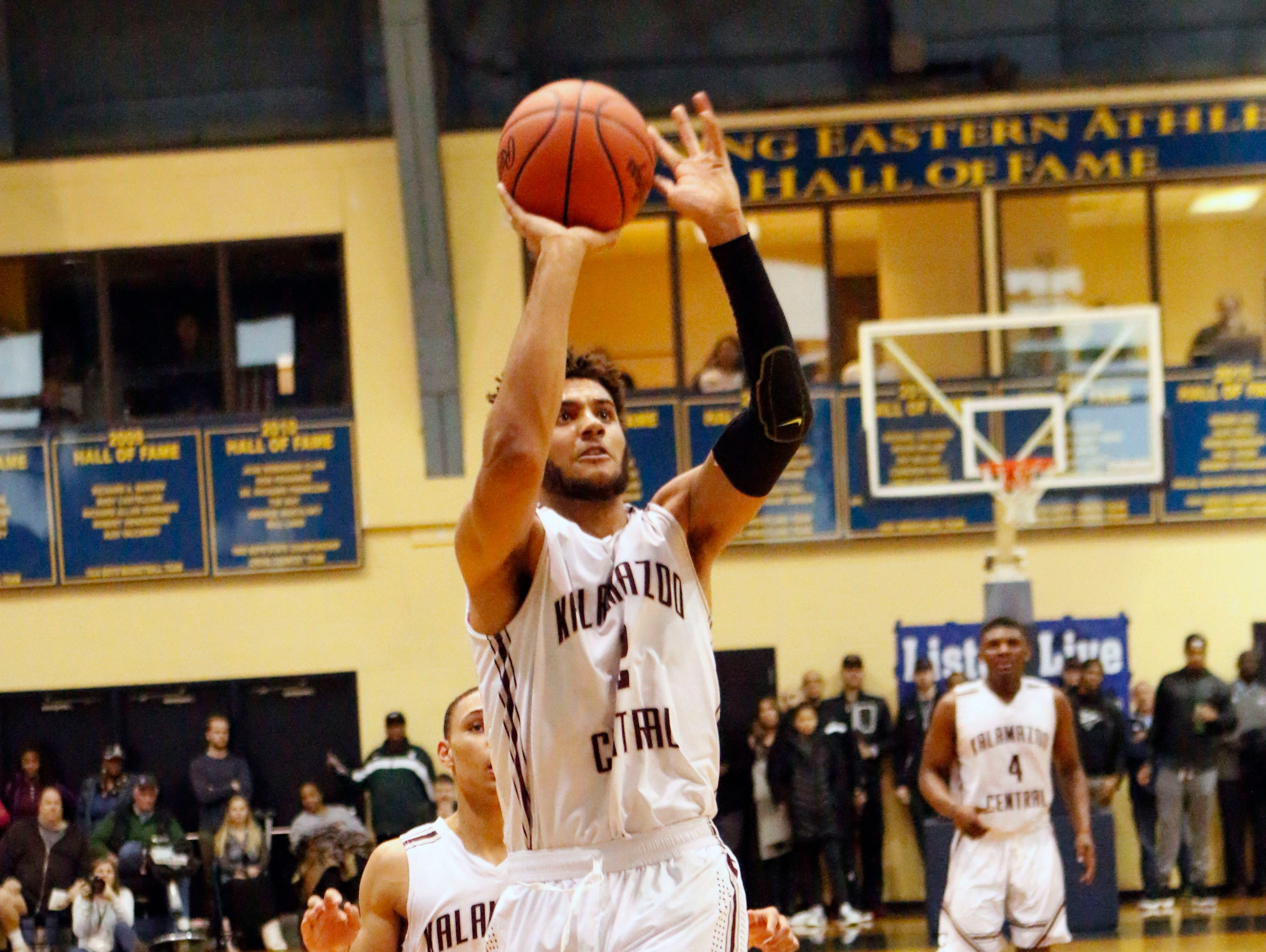 Kalamazoo Central's Isaiah Livers goes up for a shot against Grand Rapids Christian in Tuesday's Class A quarterfinal at Lansing Eastern.