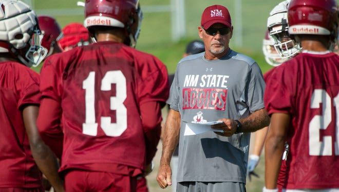New Mexico State University Head Coach Doug Martin works with his team during the first day of practice on Sunday, July 29, 2018 at the Aggie practice fields.