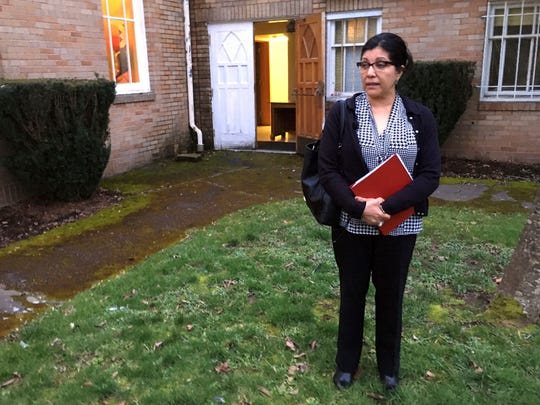 In this March 1, 2017, photo, Marta Guembes, Guatemala's honorary consul in Portland, Ore., talks about how she has been trying to help Guatemalan immigrants who were detained in the predominantly Latino town, during an interview in Woodburn, Ore. Speaking outside the offices of PCUN, a union representing farmworkers, nursery and reforestation workers in Oregon, Guembes says such detentions cause enormous pain for families in Woodburn and in Guatemala that receive money from relatives working in the U.S.