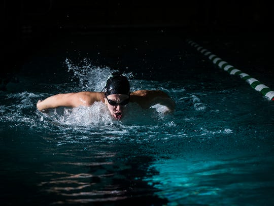Morgan Hicks swims during practice at Yorktown High