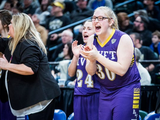 Vincennes Rivet's Livie Trent (24) and Caitlin Creech (30) react after their team scored against Marquette Catholic during their state championship game at Banker's Life Fieldhouse Saturday, Feb. 24, 2018.