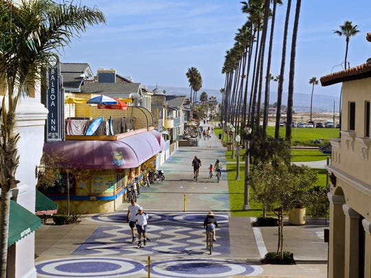 A paved Boardwalk that runs for miles along the scenic Balboa Peninsula is popular with strollers, cyclists, joggers, and skaters at Newport Beach.