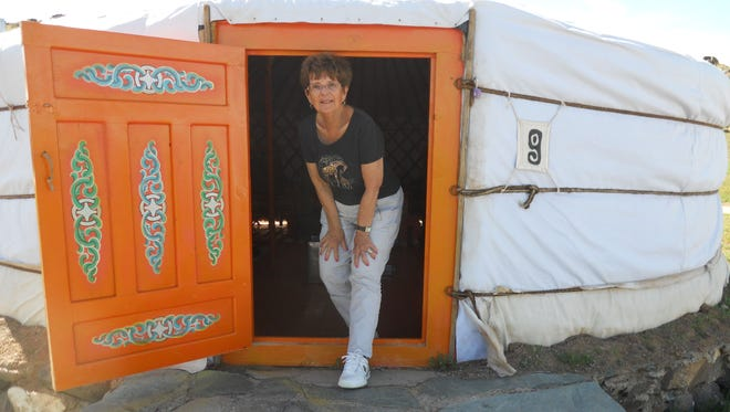 Lynn Neuville at the door of the ger (yurt) she stayed in while visiting Mongolia.