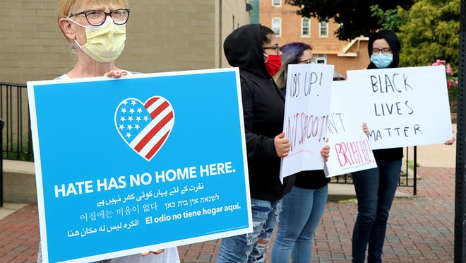 Demonstrators gathered on Center Square in downtown Waynesboro on Tuesday. TOYA MCCLEARY/THE RECORD HERALD